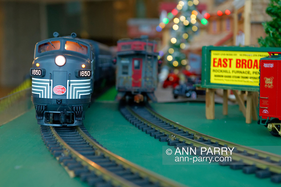 Dec. 26, 2012 - Garden City, New York, U.S. - The Long Island Garden Railway Society large-scale model train display is a festive winter holiday attraction in the vast 3-floor atrium of Cradle of Aviation museum, until shortly after New Years Day 2013. The G-scale New York Central and other train pass each other in opposite directions. LIGRS shares the knowledge, fun, and camaraderie of large-scale railroading both indoors and in the garden, and is family oriented.