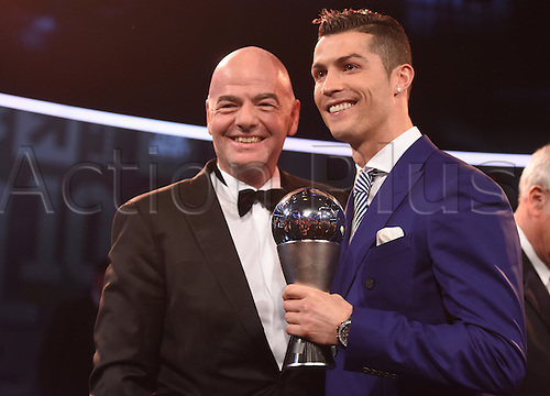09.01.2017. Zurich, Switzerland.  Portuguese footballer Cristiano Ronaldo holds his FIFA World Player of the Year 2016 award, which was presented to him by FIFA president Gianni Infantino (l), at the FIFA World Players of the Year 2016 gala in Zurich, Switzerland, 9 January 2017.