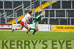 Laura Rogers Kerry pushes away from Tyrone Edel Gray during their NFL clash against Tyrone on Sunday in Fitzgerald Stadium