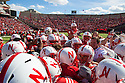 April 06, 2013: Quarterback Taylor Martinez  #3 and Jack Hoffman #22 are surrounded by the Huskers after Jack scored a touchdown for the Red team during the Red-White spring game at Memorial Stadium in Lincoln, Nebraska. The Red team defeated the White team 30 to 21.