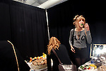 A model has a bite to eat before a fashion show, September 12, 2012, at Mercedes-Benz Fashion Week in New York, NY.