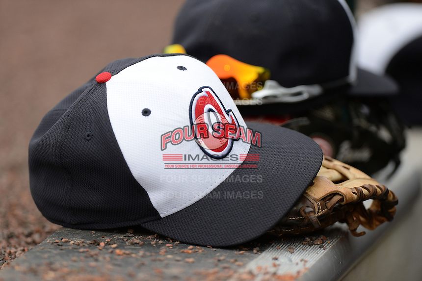 Atlanta Braves hat and glove sitting on the dugout steps during a spring training game against the Detroit Tigers on February 27, 2014 at Joker Marchant Stadium in Lakeland, Florida.  Detroit defeated Atlanta 5-2.  (Mike Janes/Four Seam Images)