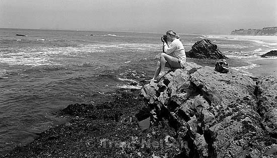 Jason Olson photographing ocean<br />