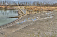 The W. Darcy McKeough Floodway concrete drop structure, used to reduce the energy of the diverted flood waters before entering the St. Clair River is marked with Sombra graffiti.