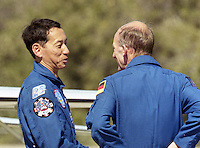 International astronauts Mamoru Mohri (left) and Gerhard P.J. Thiele arrive at Kennedy Space Center, Titusville, FL, to begin the STS 99 mission in February 2000.  (Photo by Brian Cleary/www.bcpix.com)