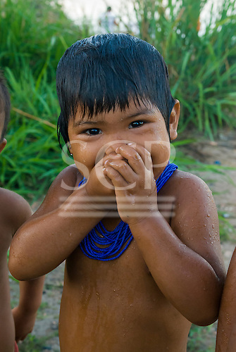 Xingu Indigenous Park, Mato Grosso State, Brazil. PIV Culuene, on the Culuene River. Kalapalo child enjoying an early morning swim.