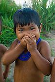 Xingu Indigenous Park, Mato Grosso State, Brazil. PIV Culuene, on the Culuene River. Kalapalo child enjoying an early morning swim.