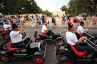 Shriners wave to spectators in Alamo Plaza during the Shriners' Imperial Parade, Tuesday, July 7, 2009, in San Antonio. (Wm. Duke/pressphotointl.com)