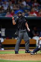 Home plate umpire Anthony Perez calls a strike during a game between the Mobile BayBears and the Jacksonville Jumbo Shrimp on April 14, 2018 at Baseball Grounds of Jacksonville in Jacksonville, Florida.  Mobile defeated Jacksonville 13-3.  (Mike Janes/Four Seam Images)