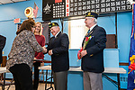 NAUGATUCK, CT. 08 December 2018-120818 - Chaplain Bill Detlefsen, center, presents Linda Kazimir with a commemorative lapel pin as Sergeant of Arms Ron Fischer, right, and Naugatuck Deputy Mayor Laurie Tad-Jackson look on during the honoring of Vietnam Veterans Spouses,  part of the the Certificate of Honor Program at the American Legion Post 17 in Naugatuck on Saturday. This is the first time in Connecticut that any type of honor has been given to the spouses. Bill Shettle Republican-American