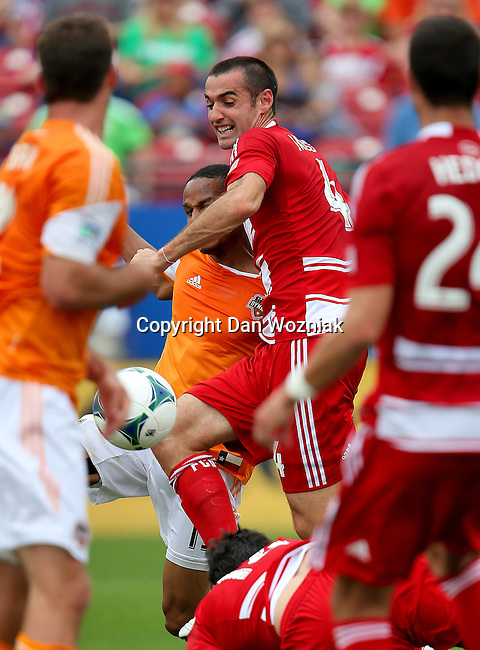 FC Dallas midfielder Andrew Jacobson (4) in action during the game between the FC Dallas and the Houston Dynamo at the FC Dallas Stadium in Frisco,Texas.