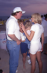 Donald Trump and Marla Maples Trump attend the Dishes Summer Beach Games on August 10, 1996 in Amagansett, New York.