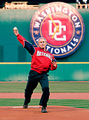US President George W. Bush throws out the first pitch to during opening night for the Washington Nationals at RFK Stadium in Washington, DC Thursday 14 April 2005. The Nationals take the field to night with a record of 5 wins 4 losses putting them in a tie for 1st place in their division.<br /> Credit: Shawn Thew / Pool via CNP