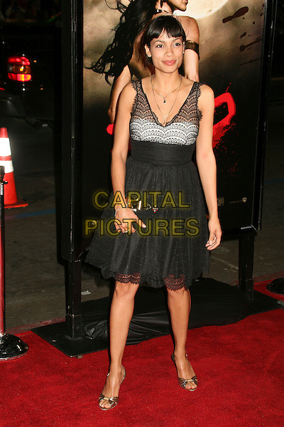"ROSARIO DAWSON.""300"" Los Angeles Premiere at Grauman's Chinese Theatre, Hollywood, California, USA..March 5th, 2007.full length black lace dress see through thru clutch purse.CAP/ADM/BP.©Byron Purvis/AdMedia/Capital Pictures"
