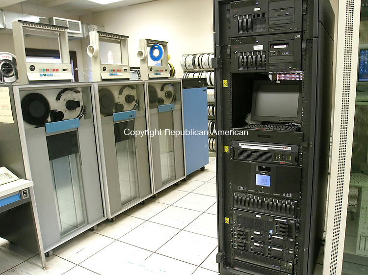 WATERBURY, CT. 28 FEBRUARY 2006- 022806BZ03- Waterbury has recently switched from paper rate cards for its employees to a computer based system.  The IBM server on the right currently controls the city payroll.  The magnetic tape system on the left was in use until the year 2000.<br /> <br /> <br /> Jamison C. Bazinet / Republican-American
