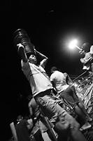 Trabalhadores descarregam cestos de a&ccedil;ai que chegam a cidade de Bel&eacute;m vindo de diversos munic&iacute;pios do estado.<br /> &copy;Paulo Santos
