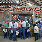 Cowboy Church. Texas, USA. 2007. The congregation of the 1,000 Hills Cowboy Church hold prayers for various parishioners. The church is based on evangelical Christianity and the laying on of hands and anointing of oil is still part of the regular Sunday service.