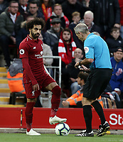 Liverpool's Mohamed Salah prepares to take a free-kick while Referee Martin Atkinson grapples with his spray can<br /> <br /> Photographer Rich Linley/CameraSport<br /> <br /> The Premier League - Liverpool v Manchester City - Sunday 7th October 2018 - Anfield - Liverpool<br /> <br /> World Copyright &copy; 2018 CameraSport. All rights reserved. 43 Linden Ave. Countesthorpe. Leicester. England. LE8 5PG - Tel: +44 (0) 116 277 4147 - admin@camerasport.com - www.camerasport.com