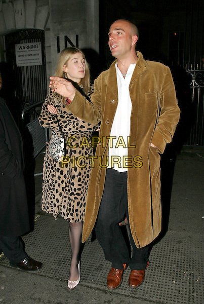 ROSAMUND PIKE.Kill Bill 2 UK Premiere, Empire Leicester Square.April 20th, 2004.full length, full-length, animal print, leoprad print coat, floral print bag, purse.www.capitalpictures.com.sales@capitalpictures.com.© Capital Pictures.