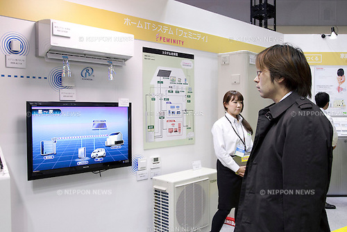 "December 13, 2012, Tokyo, Japan - A visitor sees the Toshiba eco-products on the display. The Eco-Products Exhibition is one of the biggest environmental issues in Japan, drawing more than 180,000 business people and consumer exhibitors. The theme of this year is ""The Greener, The Smaller - The Future We Will Choose"", the exhibition will be held from December 13th to 15th in Tokyo Big Sight.(Photo by Rodrigo Reyes Marin/AFLO).."