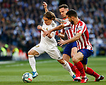Luka Modric of Real Madrid and Felipe Augusto de Almeida of Atletico de Madrid