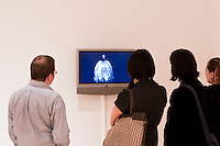 People viewing video art at the University of Washington Master of Fine Art Thesis exhibition. Photograph biy Robert Wade.