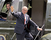 Washington, D.C. - July 11, 2008 -- United States President George W. Bush waves to well wishers as he and first lady Laura Bush depart the South Lawn of the White House in Washington, DC to spend the week-end at the Presidential Retreat at Camp David, Maryland on Friday, July 11, 2008.<br /> Credit: Ron Sachs / Pool via CNP