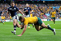 Drew Mitchell of Australia dives for the try-line. Rugby World Cup Quarter Final between Australia and Scotland on October 18, 2015 at Twickenham Stadium in London, England. Photo by: Patrick Khachfe / Onside Images