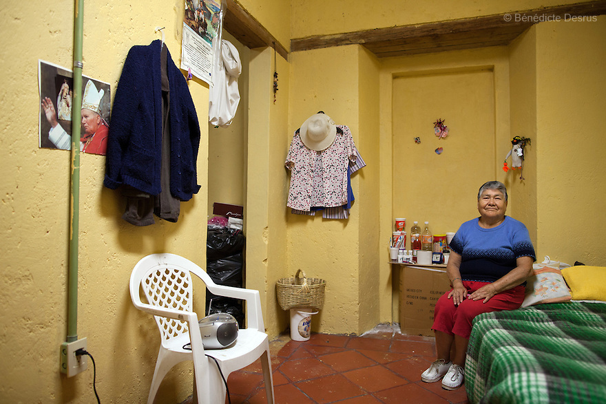 Portrait of Carmelita, a resident of Casa Xochiquetzal, in her bedroom at the shelter in Mexico City, Mexico on October 31, 2012. Casa Xochiquetzal is a shelter for elderly sex workers in Mexico City. It gives the women refuge, food, health services, a space to learn about their human rights and courses to help them rediscover their self-confidence and deal with traumatic aspects of their lives. Casa Xochiquetzal provides a space to age with dignity for a group of vulnerable women who are often invisible to society at large. It is the only such shelter existing in Latin America. Photo by Bénédicte Desrus