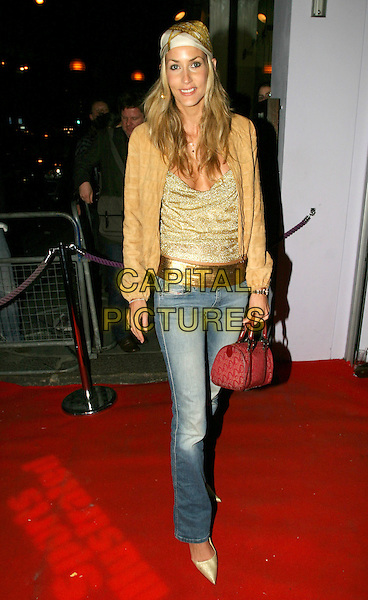 LISA BUTCHER.Sports Illustrated Swimsuit Issue 2004 - launch & 40th anniversary party.full length, full-length, gold belt, bandana, scarf, bag , purse.www.capitalpictures.com.sales@capitalpictures.com.© Capital Pictures.