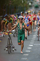 08 MAY 2004 - FUNCHAL, MADEIRA - A competitor runs through transition at the World Age Group Triathlon Championships. (PHOTO (C) NIGEL FARROW)