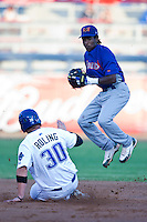August 19,2010 Jemile Weeks (24) leaps to throw to 1st during the MiLB game between the Midland RockHounds and the Tulsa Drillers at OneOk Field in Tulsa Oklahoma.