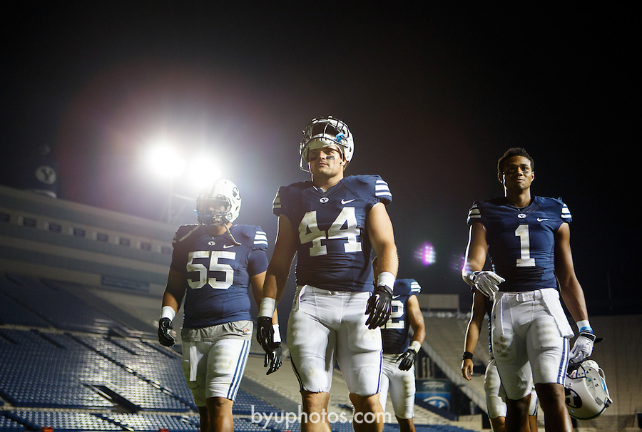 1208-48 756<br /> <br /> 1208-48 BYUtv FTB Ad, Players walking off field, Football, LVES Lavell Edwards Stadium.<br /> <br /> August 17, 2012<br /> <br /> Photo by Jaren Wilkey/BYU<br /> <br /> &copy; BYU PHOTO 2012<br /> All Rights Reserved<br /> photo@byu.edu  (801)422-7322