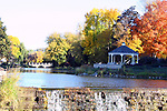 Water flowing over the Mill Pond dam in Menomonee Falls Wisconsin during the Fall Season