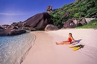 Snorkeler Suzy Forman relaxes on an idyllic beach at Ko Similan, Similan Islands Marine National Park, Thailand, Andaman Sea