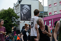 "GERMANY, Hamburg, protest rally on Reeperbahn in St. Pauli against G-20 summit in july 2017, wall billboard Fritz Cola advertisement sleeping Donald Trump, slogan ""man, get up"" / DEUTSCHLAND, Hamburg, St. Pauli, Protest Demo auf der Reeperbahn gegen G20 Gipfel in Hamburg"
