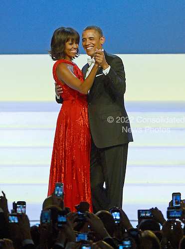 United States President Barack Obama and first lady Michelle Obama dance at the Inaugural Ball at the Washington Convention Center in .Washington, D.C. on Monday, January 21, 2013..Credit: Ron Sachs / CNP.(RESTRICTION: NO New York or New Jersey Newspapers or newspapers within a 75 mile radius of New York City)