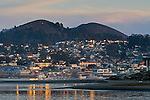 Sunset light reflected in windows at Morro Bay, California