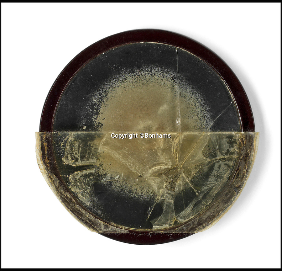 BNPS.co.uk (01202 558833)<br /> Pic: Bonhams/BNPS<br /> <br /> One of the two moulds Fleming gave to his neice Mary Anne Johnston. - Not much to look at, but his penicillin discovery has gone on to save millions of lives.<br /> <br /> Two samples of mould that Sir Alexander Fleming used to produce penicillin have emerged for sale as part of a remarkable £15,000 archive relating to the legendary scientist.<br /> <br /> Both specimens of the yellow-green Penicillium Notatum fungus are contained on a glass disc and date back to the 1930s when Fleming was developing his 1928 discovery of penicillin. <br /> <br /> The treatment has gone on the save millions of lives across the world.<br /> <br /> Indeed, as part of the archive that has emerged at Bonhams is a poignant letter of thanks from a father to the biologist for helping to save his daughter's life.