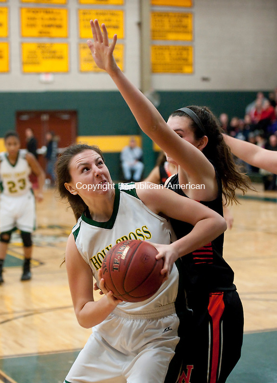 WATERBURY,  CT-010315JS06--Holy Cross' Caitlin Cipriano (33) spins around Watertown's Abigail Collier (14) to put up a shot during their game Saturday at Holy Cross High School in Waterbury.<br /> Jim Shannon Republican-American