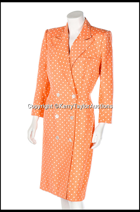 BNPS.co.uk (01202 558833)<br /> Pic:   KerryTaylorAuctions/BNPS<br /> <br /> A Catherine Walker printed peach silk polka dot coat dress Diana was seen out in on numerous occasions in the late 1980s and early '90s sold for almost £100,000.<br /> <br /> Three designer dresses worn by Princess Diana for her Royal duties have sold for over £260,000.<br /> <br /> The trio of outfits included a blue and white striped dress commissioned from the Emanuels and worn by Diana during her visit to the Gulf states with Prince Charles in 1986. That sold for £106,000 alone.<br /> <br /> A Catherine Walker printed peach silk polka dot coat dress the Princess of Wales was seen out in on numerous occasions in the late 1980s and early '90s fetched almost £100,00 at the sale in London.