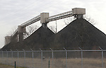 022312tvcoalpiles.Piles of coal on the opposite side of the road from the Prairie State Energy Campus facility.  The facility is getting ready to begin generating electricity..TIM VIZER/BELLEVILLE NEWS-DEMOCRAT