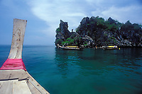 Longtail boats anchored at snorkeling site, Railay Rei Lei Beach, Thailand