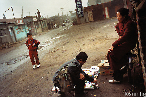 A woman sells toys in Tieling City, in China's northeastern rustbelt. .Millions of workers have been laid-off as China restructures its economy, making way for nimble manufacturing bases down south. Thousands of unemployed workers from Tieling have fled to Europe as clandestine immigrants..Picture taken by Justin Jin in Tieling city, Liaoning Province, China, 11-2003