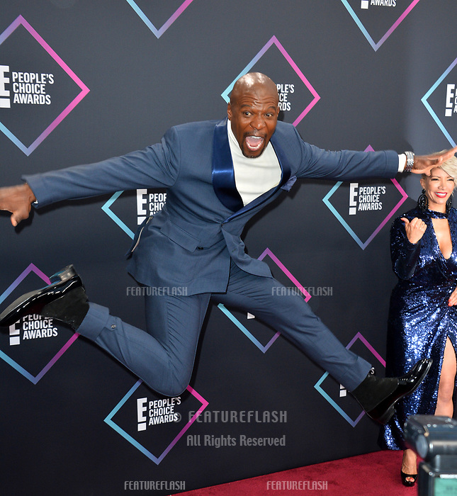 LOS ANGELES, CA. November 11, 2018: Terry Crews & Rebecca King-Crews at the E! People's Choice Awards 2018 at Barker Hangar, Santa Monica Airport.<br /> Picture: Paul Smith/Featureflash