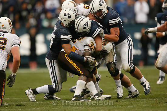 Trent Nelson  |  The Salt Lake Tribune.A trio of BYU defenders bring down Wyoming's Alvester Alexander during the second half, BYU vs. Wyoming, college football Saturday, October 23, 2010 at LaVell Edwards Stadium in Provo. BYU won 25-20.