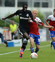 3. Fussball Bundesliga:  2. Spieltag    Saison   2012/2013   SpVgg Unterhaching  - FC Hansa Rostock   28.07.2012 Alexandre Noel Mendy (li, FC Hansa Rostock) gegen Sascha Bigalke (Unterhaching)