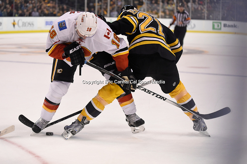 Tuesday March 1, 2016: Calgary Flames center Matt Stajan (18) and Boston Bruins left wing Loui Eriksson (21) battle for the puck during the National Hockey League game between the Calgary Flames and the Boston Bruins, held at TD Garden, in Boston, Massachusetts. Boston defeats Calgary 2-1 in regulation time. Eric Canha/CMS