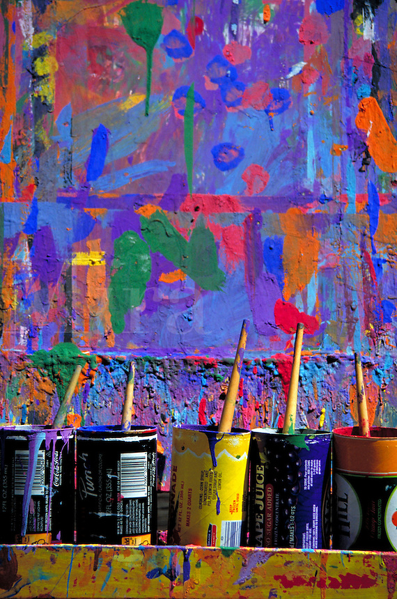 Colorful art easel with paint brushes.