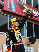 Jul 22, 2018; Morrison, CO, USA; NHRA top fuel driver Leah Pritchett celebrates after winning the Mile High Nationals at Bandimere Speedway. Mandatory Credit: Mark J. Rebilas-USA TODAY Sports